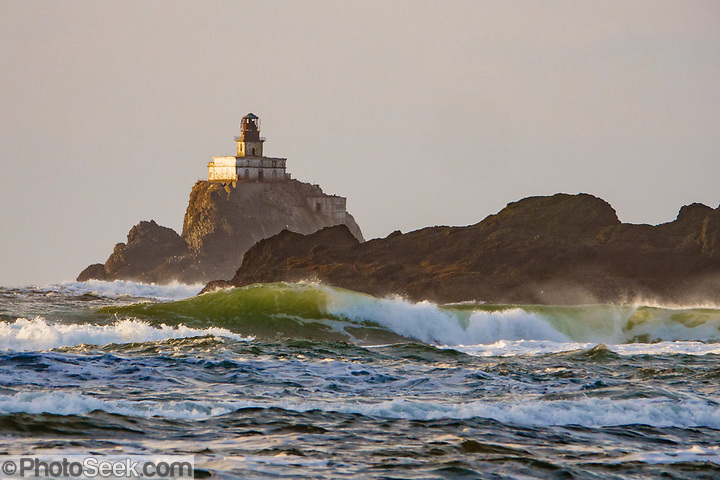 Tillamook Lighthouse clings to a sea stack amid crashing waves, seen from Chapman Beach. Cannon Beach city, Oregon coast, USA. (© Tom Dempsey / PhotoSeek.com)