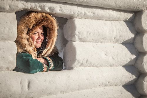 "Alaya Burg inside a snow log house at the GCI Rondy Snow Sculpture Competition.  ""I grew up in Anchorage an am Athabaskin and Yup'ik.""   Aiamalaya84@gmaiol.com (© Clark James Mishler)"