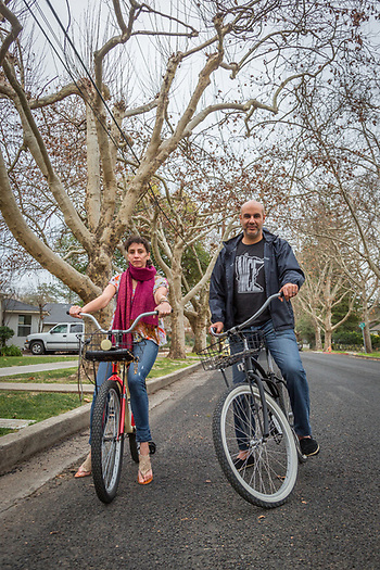 """We live in Minneapolis, where the tempertures are in single digits.  I can't believe I'm riding a bike in sandals... we go back tomorrow.""          -Linda Obeid and her husband, Adel El-Huni, ride bicycles on Cedar Street in Calistoga. (Clark James Mishler)"