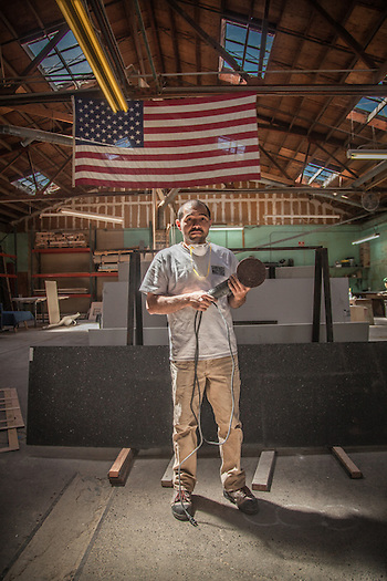 Stone finisher and fabricator Cesar Moran at Surface Masters in Napa, CA. (Clark James Mishler)