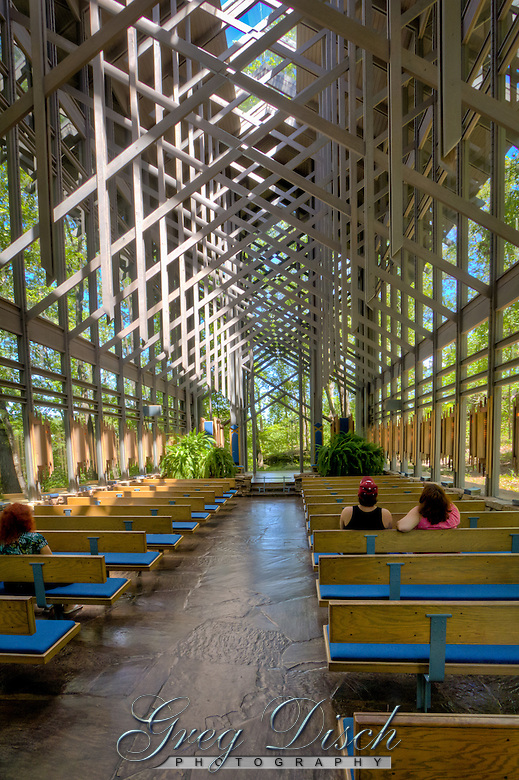 Thorncrown Chapel is located in Eureka Springs Arkansas..The chapel rises 48 feet into the sky with over 6,000 square feet of glass and 425 windows. Its dimensions are 24 feet by 60 feet. The chapel is made with all organic materials to fit its natural setting. The only steel in the structure forms a diamond shaped pattern in its wooden trusses. The building has a native flagstone floor surrounded with a rock wall which gives the feeling that the chapel is part of its Ozark hillside. (Greg Disch)