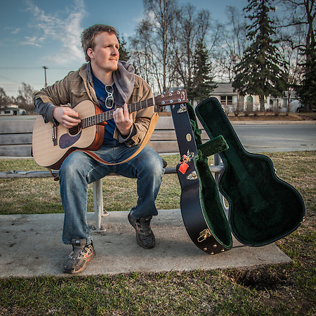 "Musician Ryan Noland with his guitar on the west end of the Delaney Park Strip, Anchorage.  ""For a long time I wanted to be a musician…now I want to start my own construction company…and make some money."" ranoland8@gmail.com (© Clark James Mishler)"