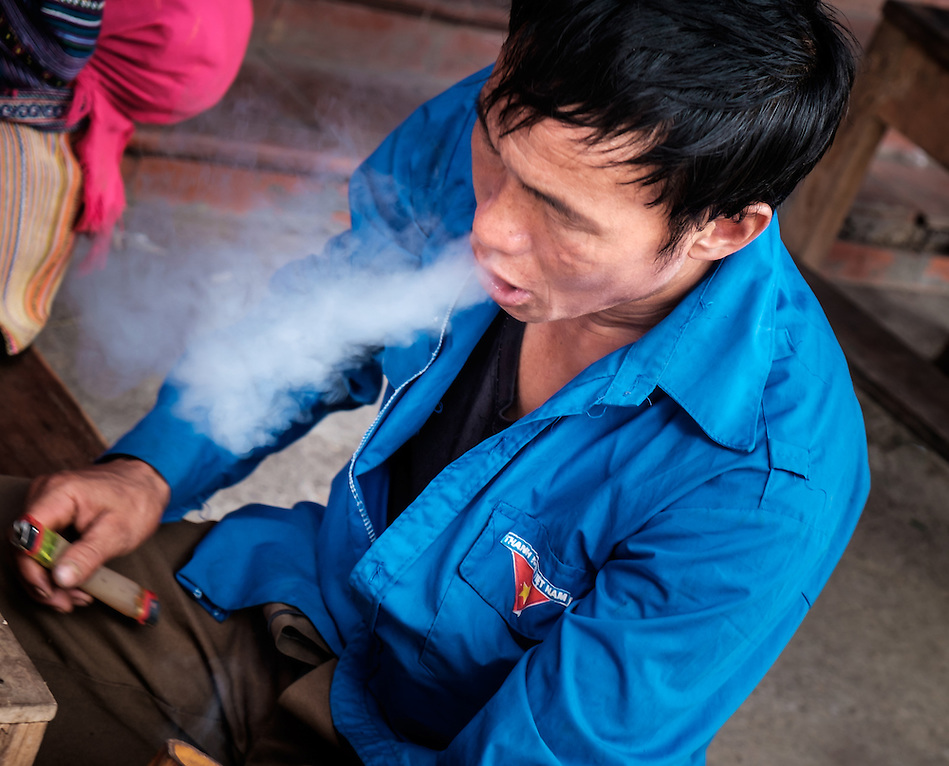 BAC HA, VIETNAM - CIRCA SEPTEMBER 2014:  Vietnamese man smoking at the Bac Ha sunday market, the biggest minority people market in Northern Vietnam (Daniel Korzeniewski)