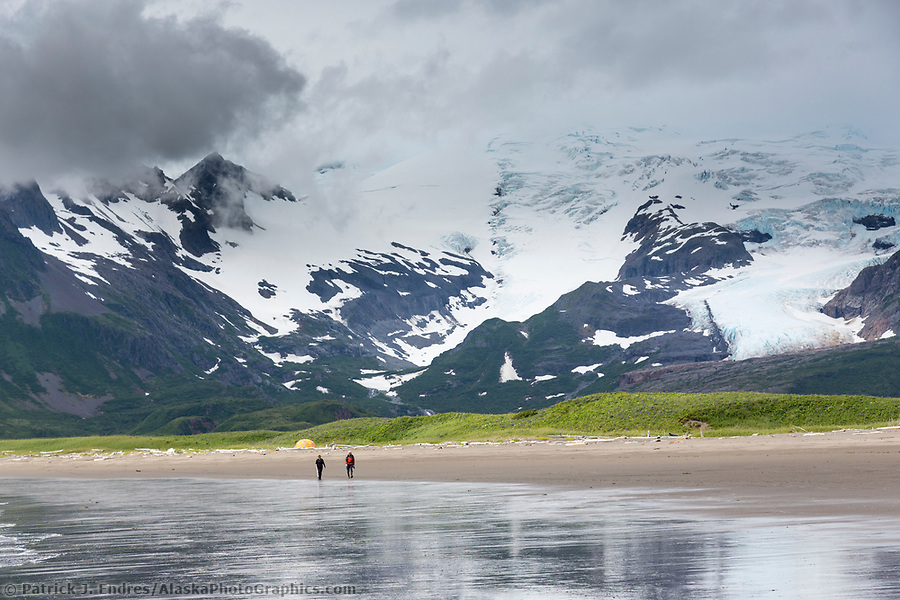 Hikers walk along the sandy beach on the coast of Katmai National Park, Alaska Peninsula, southwest Alaska. (Patrick J. Endres / AlaskaPhotoGraphics.com)