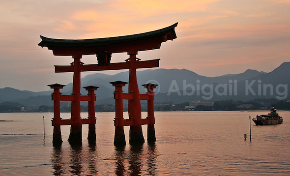View from Miyajima towards Hiroshima - sunset & torii rising from the water