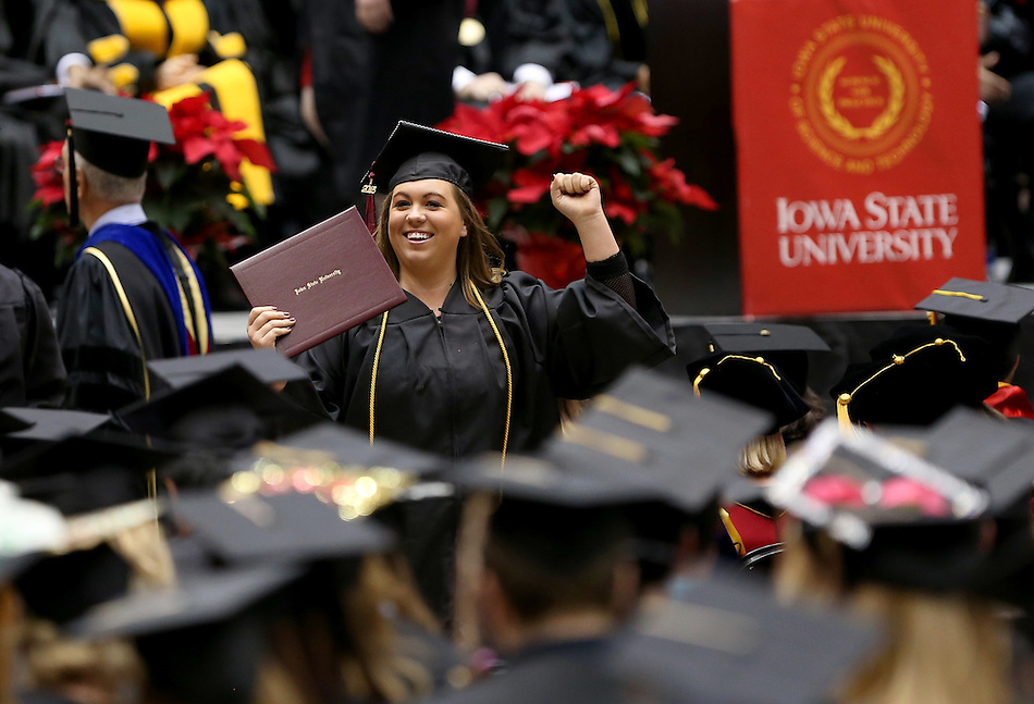 Sami Good, an event management graduate from Fort Dodge, celebrates her diploma during Iowa State University Fall commencement ceremonies Saturday, December 19, 2015, at Hilton Coliseum. (Christopher Gannon/Iowa State University) (Christopher Gannon)
