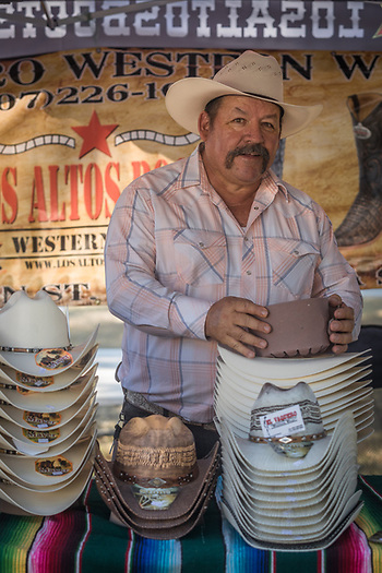"""Sales are very very good!""  -Adolfo Pena owner of Evaquero Western Wear sells hats during the Napa County Fairgrounds July Fourth weekend celebration in Calistoga (Clark James Mishler)"