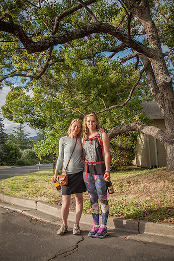 "Minneapolis adaptive yoga instrctor Kathy Dahl and her daughter Madi at Cedar and South Oak Streets in Calistoga.  ""Madi is attending school in Colorado so we decided to meet here and celebrate her 21st birthday...thus the wine bottles."" (Clark James Mishler)"