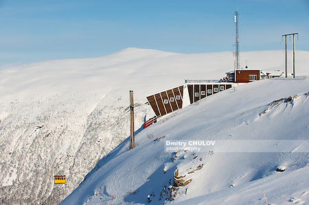 TROMSO, NORWAY - MARCH 29, 2011: Cabin of the Fjellheisen aerial tramway arrives to the upper station at the top of the Fjellheisen mountain in Tromso, Norway. (Dmitry Chulov)