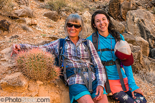 Arizona Raft Adventures (AZRA) trip leader Lorna Corson hugs a cactus next to assistant guide Bekah Martin. Hike to the prehistoric Nankoweap Granaries (1 mile round trip with 700-foot gain) from Main Nankoweap Camp at Colorado River Mile 53.4 in Marble Canyon. This image is from Day 3 of 16 days boating 226 miles down the Colorado River in Grand Canyon National Park, Arizona, USA. For this photo's licensing options, please inquire at PhotoSeek.com. . (© Tom Dempsey / PhotoSeek.com)
