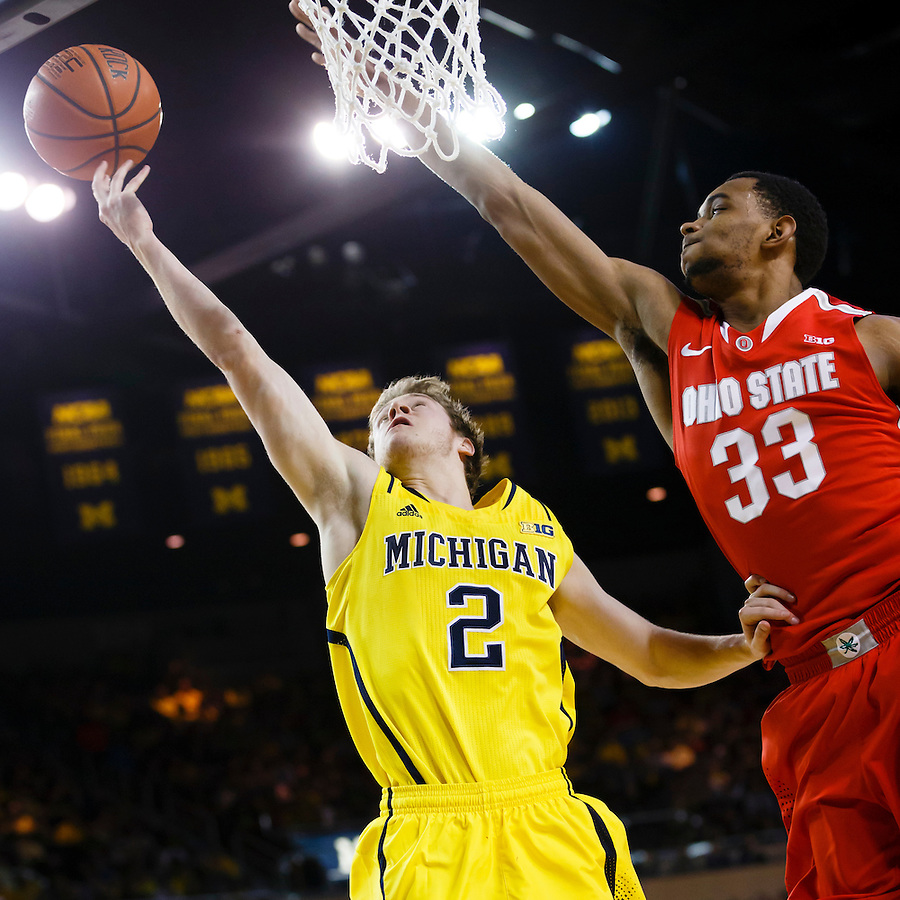 Feb 22, 2015; Ann Arbor, MI, USA; Michigan Wolverines guard Spike Albrecht (2) drives to the net is guarded by Ohio State Buckeyes forward Keita Bates-Diop (33) in the first half at Crisler Center. Mandatory Credit: Rick Osentoski-USA TODAY Sports (Rick Osentoski/Rick Osentoski-USA TODAY Sports)