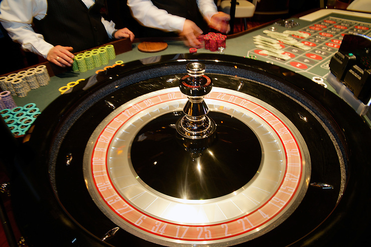 Dealers at work at one of the tables of the Revel Casino. (Bas Slabbers/for NewsWorks, file) (Bas Slabbers)