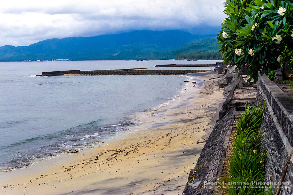 Bali, Karangasem, Candidasa. The beach is dominated by ugly concrete breakers. Looking west,the oil storage in Labuhan Amuk is visible in the background. Some are afraid that an oil spill here one day will destroy the beaches. (Photo Bjorn Grotting)