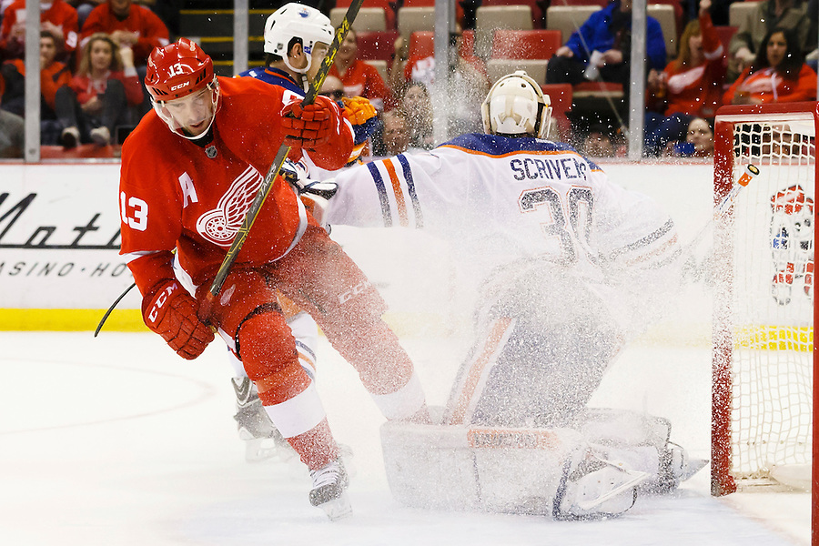 Mar 9, 2015; Detroit, MI, USA; Detroit Red Wings center Pavel Datsyuk (13) sprays Edmonton Oilers goalie Ben Scrivens (30) with snow in the third period at Joe Louis Arena. Detroit won 5-2. Mandatory Credit: Rick Osentoski-USA TODAY Sports (Rick Osentoski/Rick Osentoski-USA TODAY Sports)