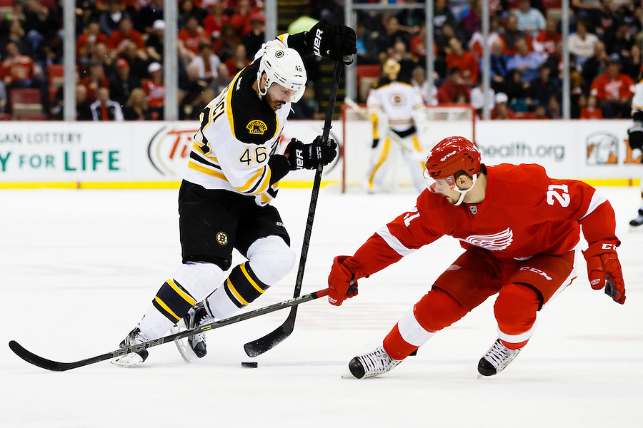Apr 2, 2015; Detroit, MI, USA; Boston Bruins center David Krejci (46) and Detroit Red Wings left wing Tomas Tatar (21) battle for the puck in the second period at Joe Louis Arena. Mandatory Credit: Rick Osentoski-USA TODAY Sports (Rick Osentoski/Rick Osentoski-USA TODAY Sports)