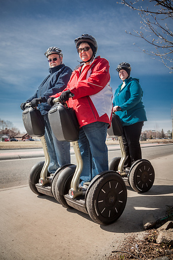 New York residents David and Cheryl Stone with their Segway guide, Marla, on Ninth Avenue, Anchorage (Clark James Mishler)