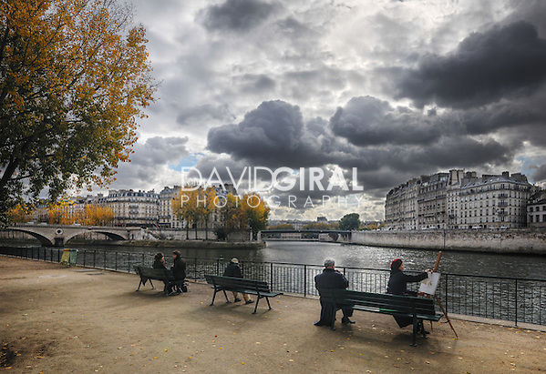 people sitting and painting on the Seine quays on a beautiful cloudy afternoon (David Giral/David Giral Photography)