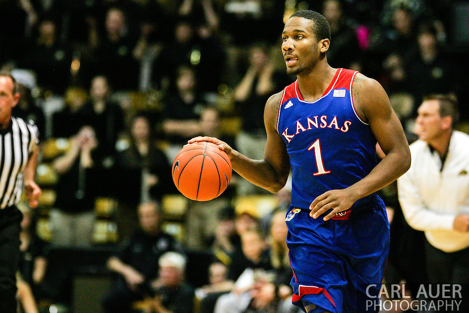 December 7th, 2013:  Kansas Jayhawks freshman guard Wayne Selden, Jr. (1) brings the ball up the quart in the first half of the NCAA Basketball game between the Kansas Jayhawks and the University of Colorado Buffaloes at the Coors Events Center in Boulder, Colorado (Carl Auer/ZUMAPRESS.com)