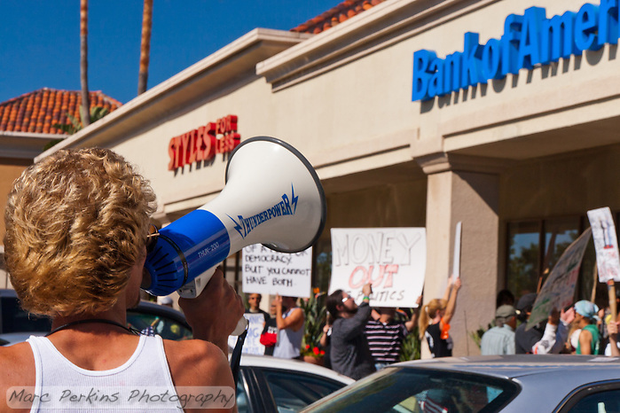 """Web"" (Andrew) leads a chant at a Bank of America in Irvine, CA during the Occupy Orange County, Irvine march on Saturday November 5. (Marc C. Perkins)"
