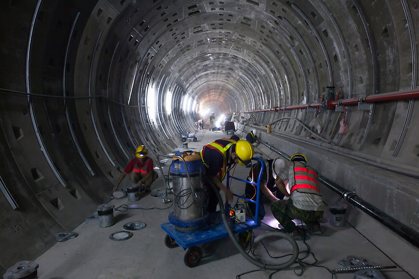 Workers inspecting a hole during construction of the Songshan line of Taipei's MRT system. (Craig Ferguson)