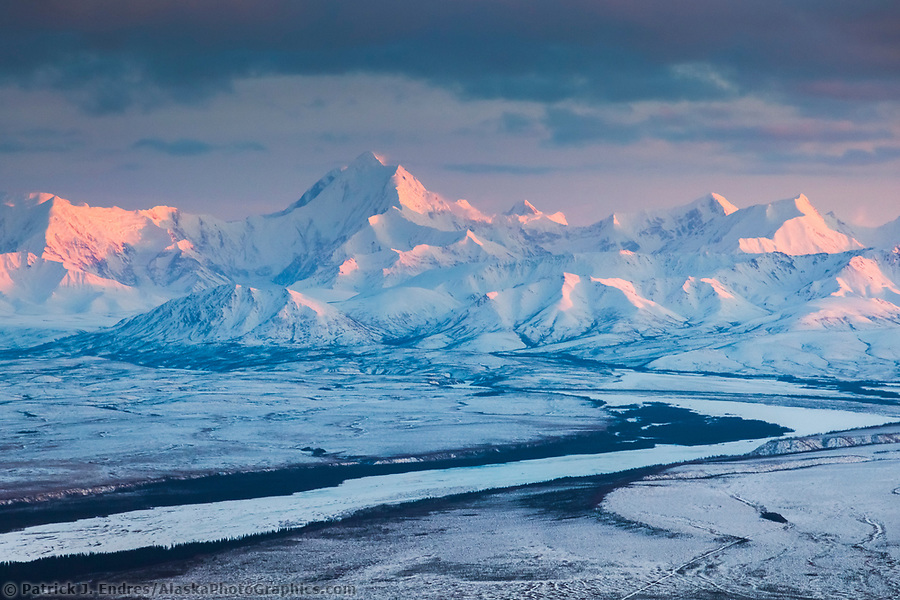Aerial of alpenglow light on the snow-covered peak of Mount Hayes, 13,832 feet (4,216 m), the highest mountain in the eastern Alaska Range. view looking southwest. (Patrick J. Endres / AlaskaPhotoGraphics.com)