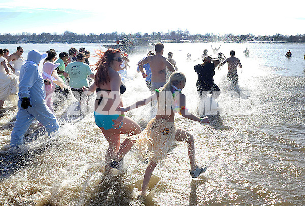 A group of plungers run into the 32 degree Delaware River during the eighth annual Eastern Polar Bear Plunge to benefit Special Olympics Pennsylvania (SOPA) Saturday January 30, 2016 at Neshaminy State Park in Bensalem, Pennsylvania. (Photo by William Thomas Cain) (William Thomas Cain/Cain Images)