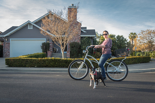 """I wanted to have a new year's bicycle ride on this beautiful day in Calistoga.""  -Ilya Smock tours the streets of Calistoga with her dog Maisey Beans.  ilya.sylvia@gmail.com (Clark James Mishler)"