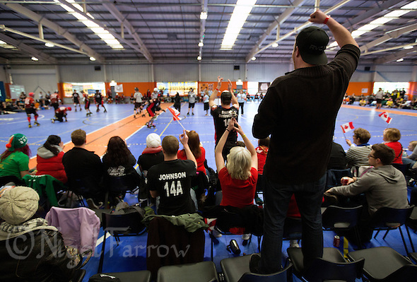 15 MAR 2014 - BIRMINGHAM, GBR - A Team Canada fan cheers on his team during the inaugural Men's Roller Derby World Cup in the Futsal Arena in Birmingham, West Midlands, Great Britain (PHOTO COPYRIGHT © 2014 NIGEL FARROW, ALL RIGHTS RESERVED) (NIGEL FARROW/COPYRIGHT © 2014 NIGEL FARROW : www.nigelfarrow.com)