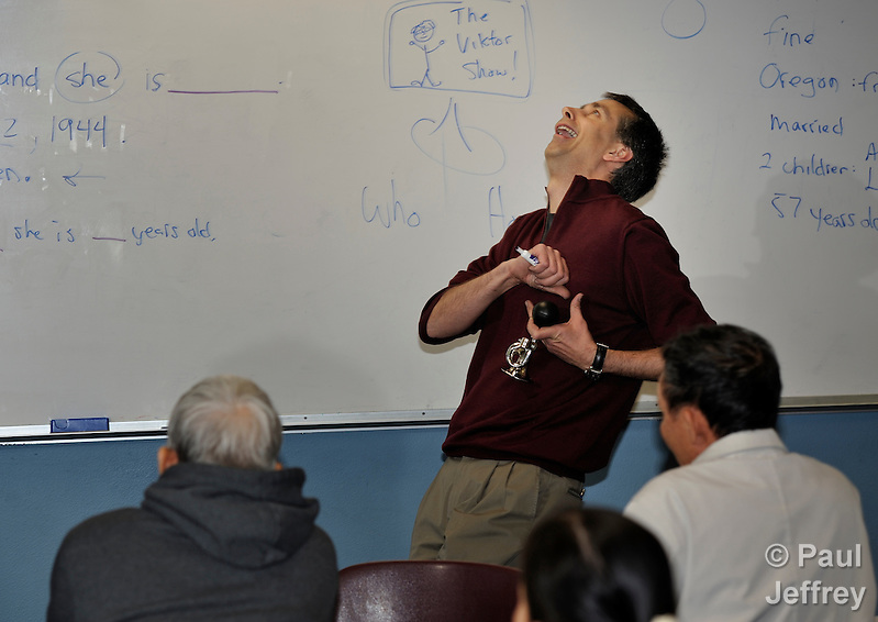Instructor Christian Jensen fakes a heart attack in response to a student's answer during an English as a second language class at Tacoma Community House in Tacoma, Washington. (Paul Jeffrey/Response)