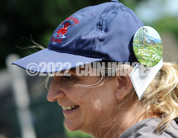 "Lauren Travis, of New Hope, Pennsylvania wears a cap with a button for the Bucks County Plein Air Festival Wednesday June 8, 2016 at the Mercer Museum in Doylestown, Pennsylvania. The competitively-selected artists will paint outdoors ""en plein air"" or ""in open air"" over the course of three days in various locations throughout the county to create various landscapes and streetscapes. (Photo by William Thomas Cain) (William Thomas Cain)"