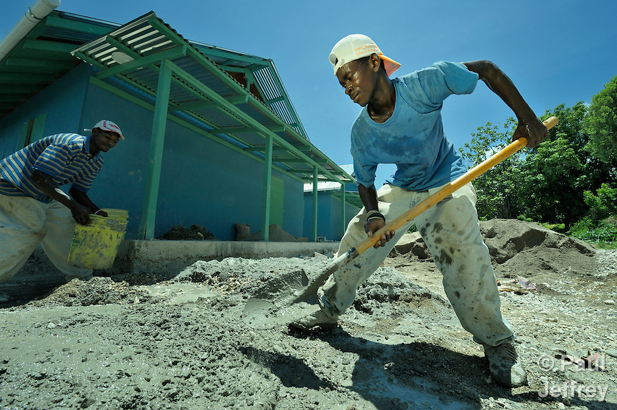 A man mixes cement with a shovel at a school under construction in Tabarre Issa, Haiti. The construction is supported by the United Methodist Committee on Relief (UMCOR), as part of its assistance to Haitians affected by the 2010 earthquake.