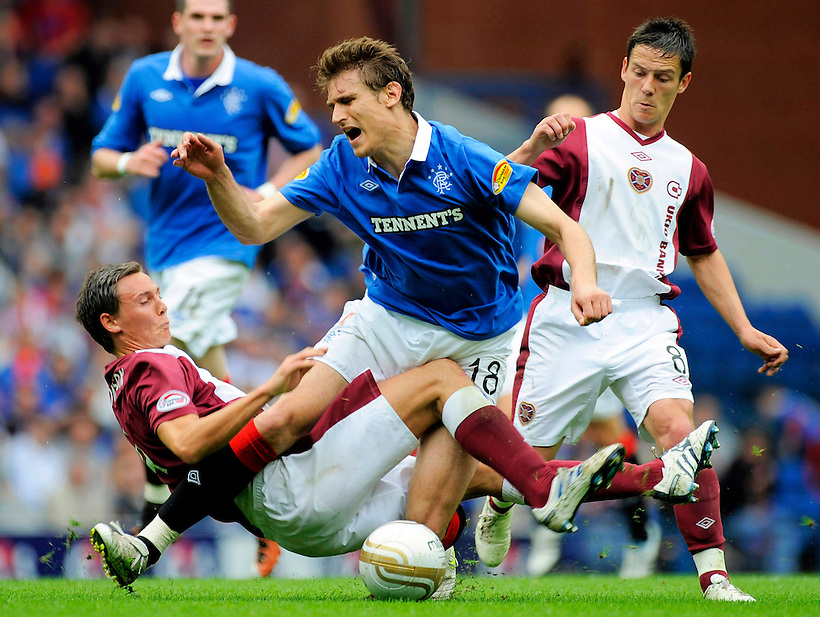 7TH MAY 2011, RANGERS V HEARTS, IBROX STADIUM, GLASGOW, EGGERT JONSSON FOUL ON NIKICA JELAVIC EARNS HIM A RED CARD, ROB CASEY PHOTOGRAPHY (ROB CASEY/ROB CASEY PHOTOGRAPHY)