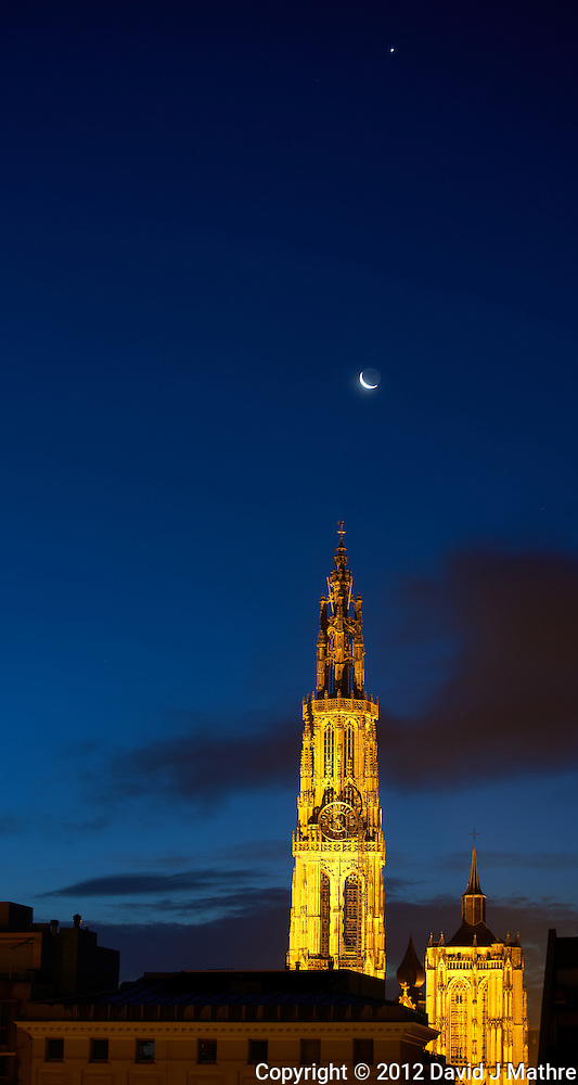 Early Dawn Jupiter and Waning Crescent Moon Over the Antwerp Cathedral from the Deck of the M/V Explorer. Image taken with a Nikon D800 and 70-300 mm VR lens (ISO 100, 70 mm, f/5.6, 2 sec). (David J Mathre)