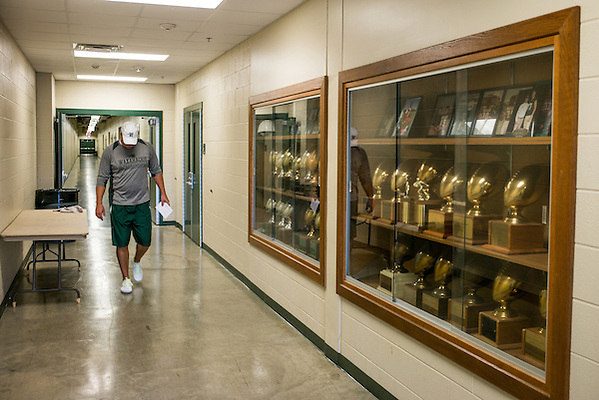 Waxahachie, Texas - September 5, 2015: Jon Kitna, Head Football Coach at Waxahachie High School walks past a trophy case outside the locker room beneath Lumpkins Stadium in Waxahachie, Texas. This is Kitna's first year as head coach at the school. (Darren Carroll for ESPN) (Darren Carroll)