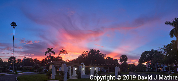 Colorful clouds after sunset. Andalusia Plaza in Granada Terrace. Historic Northeast St. Petersburg, Florida. Composite of 7 images taken with a Leica CL camera and 23 mm f/2 lens (ISO 400, 23 mm, f/2.8, 1/125 sec). Raw images processed with Capture One Pro and AutoPano Giga Pro. (DAVID J MATHRE)