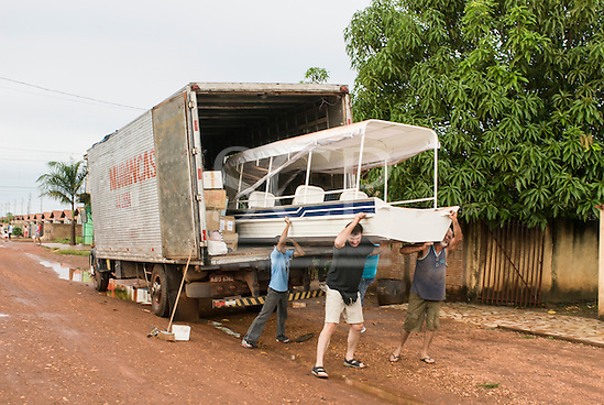 "Canarana, Mato Grosso, Brazil. Taking the boat ""Coração do Brasil"" out of the delivery truck. (Sue Cunningham/SCP)"