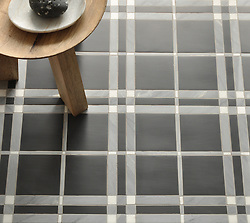 McIntyre™, a stone mosaic, shown in Thassos, Bardiglio, and Nero Marquina honed, is part of the Plaids and Ginghams Collection by New Ravenna Mosaics. (New Ravenna ®)