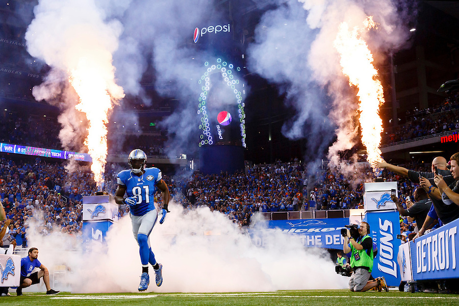 Detroit Lions wide receiver Calvin Johnson (81) runs out during player introductions for the Lions' NFL football game against the Denver Broncos, Sunday, Sept. 27, 2015, in Detroit. (AP Photo/Rick Osentoski) (Rick Osentoski/AP)