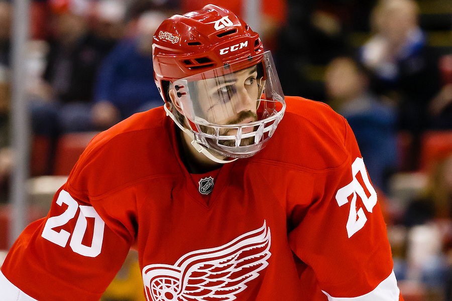 Apr 2, 2015; Detroit, MI, USA; Detroit Red Wings left wing Drew Miller (20) is seen with sixy stitches in his face as he waits for the face off during the third period against the Boston Bruins at Joe Louis Arena. Boston won 3-2. Mandatory Credit: Rick Osentoski-USA TODAY Sports (Rick Osentoski/Rick Osentoski-USA TODAY Sports)