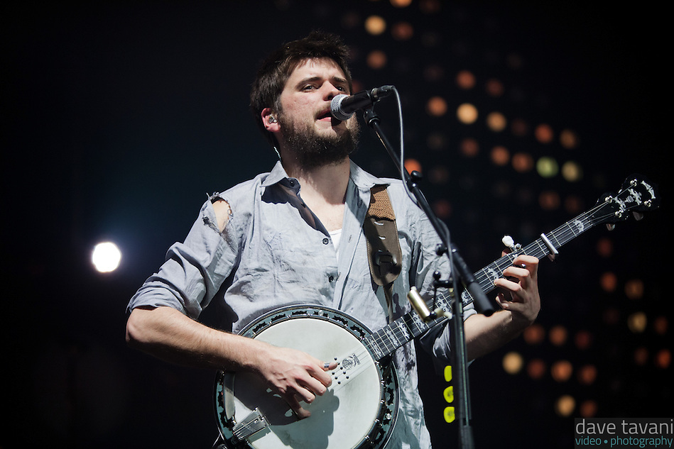 "Winston Marshall plays the banjo during the hit ""Little Lion Man,"" from Mumford & Sons' debut album Sigh No More at the Susquehanna Bank Center on February 16, 2013. (Dave Tavani)"