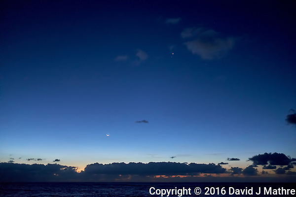The Moon, Venus. and Mercury visible at dawn from the deck of the MV World Odyssey while traveling across the Pacific Ocean. Image taken with a Fuji X-T1 camera and 23 mm f/1.4 lens (ISO 800, 23 mm, f/2, 1/60 sec). (David J Mathre)