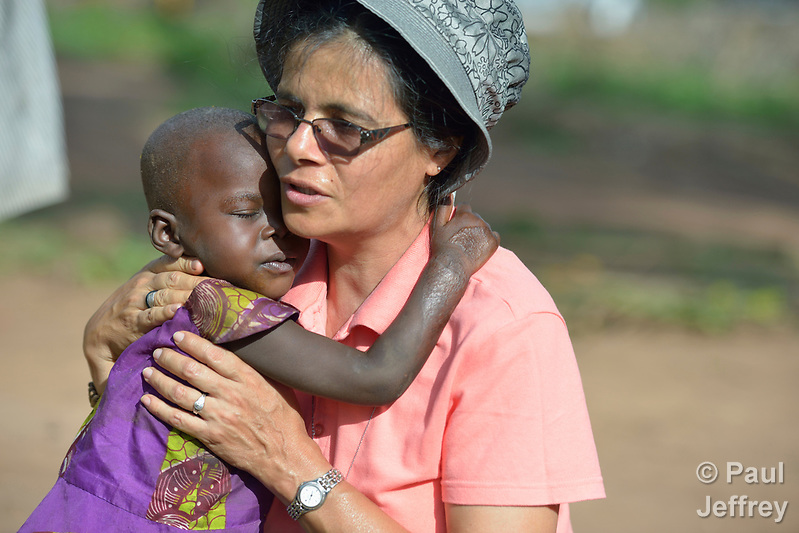 Sister Raquel Peralta, a Catholic nun from Paraguay, hugs a girl in a camp for more than 5,000 displaced people in Riimenze, in South Sudan's Gbudwe State, what was formerly Western Equatoria. Families here were displaced at the beginning of 2017 as fighting between government soldiers and rebels escalated. Peralta is a member of the Missionary Sisters Servants of the Holy Spirit, and works in South Sudan as part of Solidarity with South Sudan, an international network of Catholic groups working in the newly independent country. Solidarity and Caritas Austria have both supported efforts by the diocese to ensure that the displaced families here have food, shelter and water. (Paul Jeffrey)