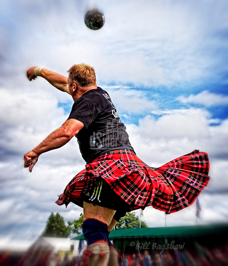 Swirling kilts as The Heavies put the stone at The Aboyne Highland Games,Royal Deeside,Scotland. dSider online magazine www.dsider.co.uk Photography by Bill Bagshaw photography courses (Bill Bagshaw & Martin Williams/Bill Bagshaw, dsider.co.uk)