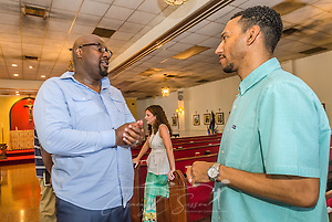 Urban Hope Community Church pastor Alton Hardy talks with church treasurer Dion Watts after the Sunday service, July 19, 2015, in Fairfield, Ala. In the background is church member Emily Sadler. (Photo by Carmen K. Sisson/Cloudybright) (Carmen K. Sisson/Cloudybright)
