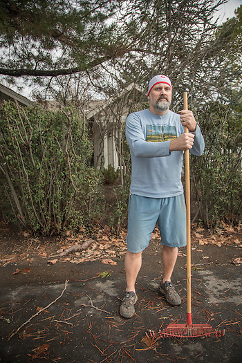 """I think its important to get out and elevate the heart rate.""  -Winery sales and hospitality employee John DeGregory cleans up post-storm debris in front of his home on Oak Street in Calistoga. (Clark James Mishler)"