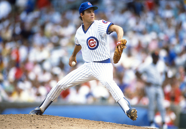 CHICAGO - CIRCA 1988:  Greg Maddux of the Chicago Cubs pitches during an MLB game at Wrigley Field in Chicago, Illinois.  Maddux played for the Cubs from 1986-1992. (Photo by Ron Vesely) (Ron Vesely)