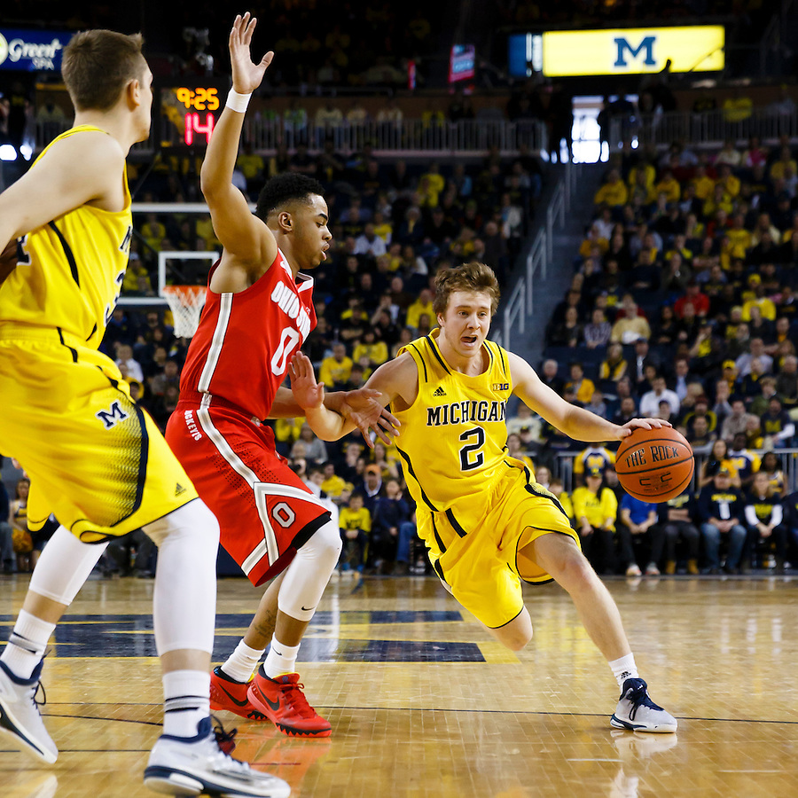Feb 22, 2015; Ann Arbor, MI, USA; Michigan Wolverines guard Spike Albrecht (2) dribbles the ball down the court is guarded by Ohio State Buckeyes guard D'Angelo Russell (0) in the first half at Crisler Center. Mandatory Credit: Rick Osentoski-USA TODAY Sports (Rick Osentoski/Rick Osentoski-USA TODAY Sports)