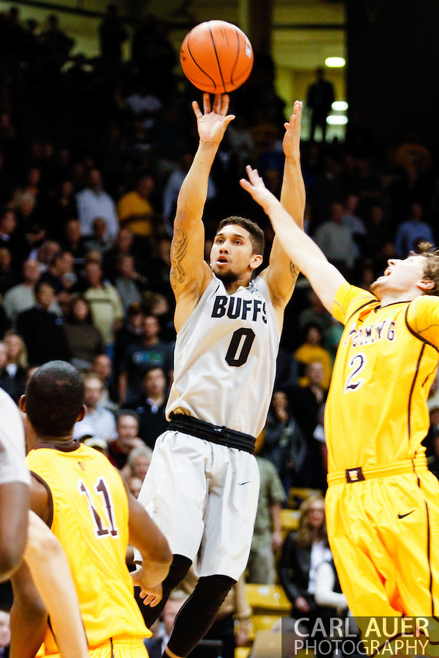 November 13th, 2013:  Colorado Buffaloes junior guard Askia Booker (0) attempts a shot in first half action of the NCAA Basketball game between the University of Wyoming Cowboys and the University of Colorado Buffaloes at the Coors Events Center in Boulder, Colorado (Carl Auer/ZUMAPRESS.com)
