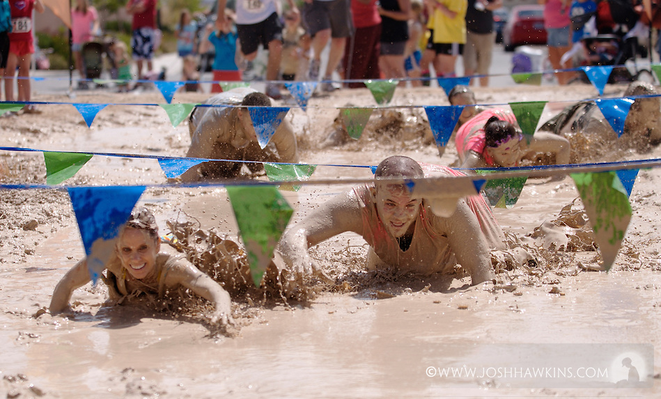 The last section, the mud section, of the Mad Mud Run in the Providence neighborhood of Las Vegas, NV from May 21st, 2011.  The total run was 4.6 miles capped off with about 20 yards of crawling though mud with crowds cheering and booing, (booing if the competitor didn't get really into the mud). (Josh Hawkins)