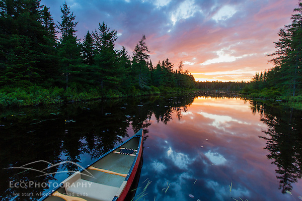 A canoe at sunrise on Little Berry Pond in Maine's Northern Forest. Cold Stream watershed, Johnson Mountain Township. (Jerry and Marcy Monkman)